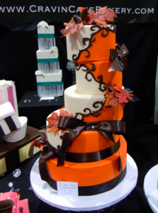 multi-tiered wedding cake in orange, chocolate, and cream colors