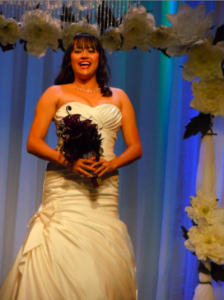laughing bride with gorgeous, full-figured strapless dress