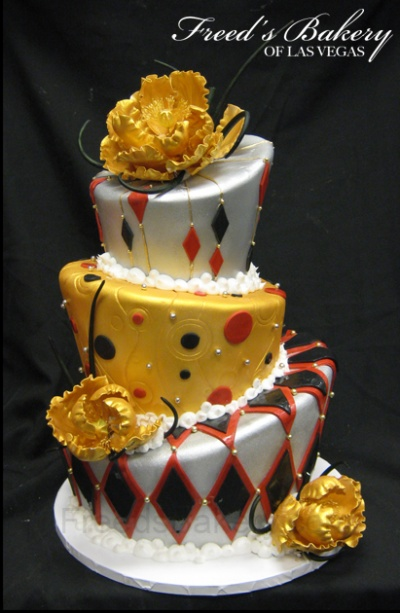 Mad Hatter Cake in gold, white, black, and red