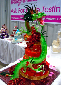 red and gold tiered wedding cake with prominent Chinese Dragon