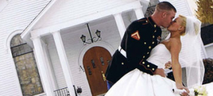 Military groom kisses his bride