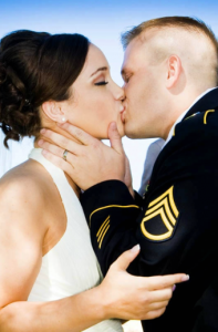 Military groom and bride kiss