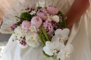 Peonies, orchids, hanging amaranthus, and stephanotus