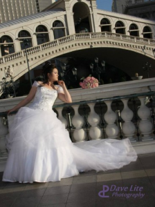bride beneath elegant bridge