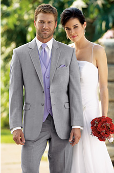 Man in light gray tuxedo with lavender tie, vest, and pocket square