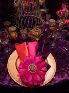 place setting with purple, gold, and orange