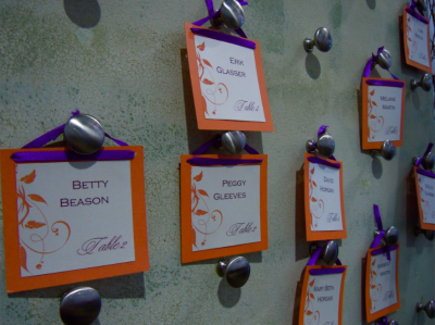 escort cards in orange and purple