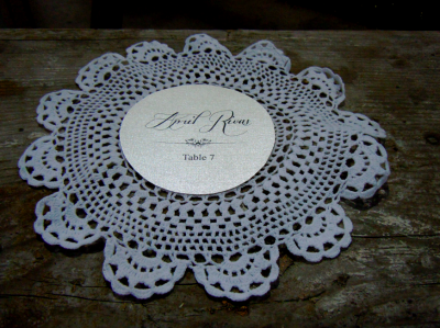 circular escort card on doily