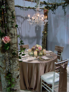 woodland display with roses, ivy, and crystal chandelier