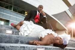 fashion forward bride and groom on stairs