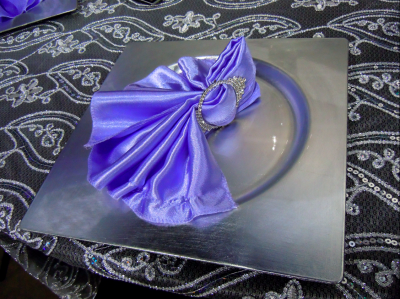 purple napkin with rhinestone ring on square, silver plate