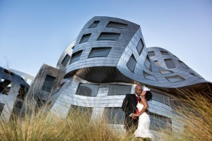 bride and groom at reflective building