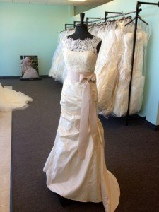 Lace overlay and satin wedding gown