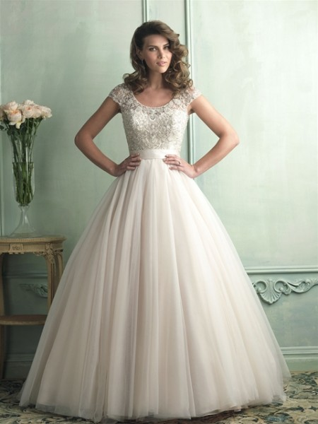 Allure Bridals English net ball gown with beaded bodice and capped sleeves .