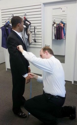 Jerry's client being measured and fitted by their professional staff.