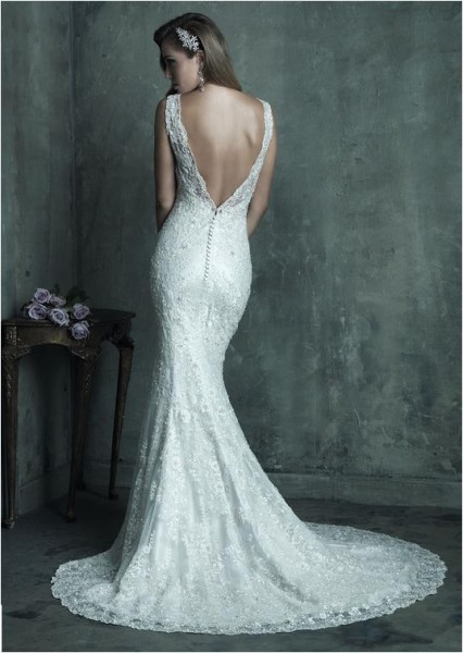 Allure Bridals fitted silhouette, v-neckline gown with plunging back and beaded overlay.