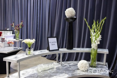 Mr. and Mrs. Smith display table with white, black, silver and green