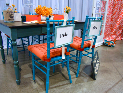 Retro Funk tablescape, teal chiavari chairs wth orange cushions