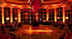 Ballroom with uplighting and draped linens