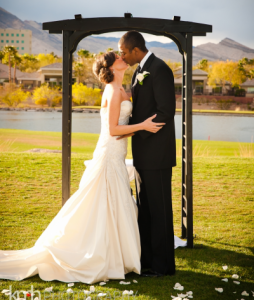 bride and groom kiss at TPC Las Vegas
