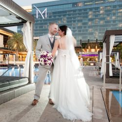 Adam Frazier Captures Hilary and Mike's Chic Purple & White Wedding at M Resort