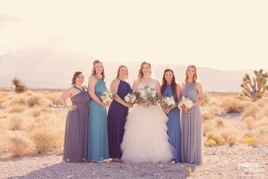 bride and her bridesmaids in blue dresses at the Las Vegas Paiute Golf Resort