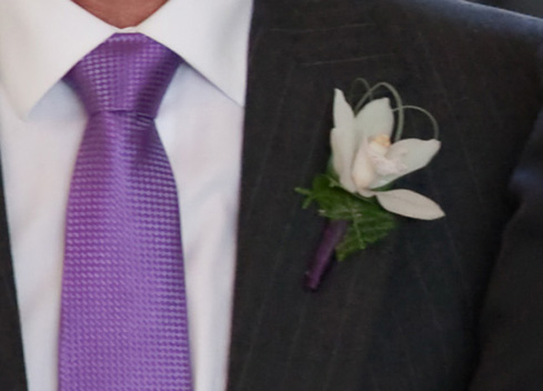 Boutonniere for the Best Man, Father of the Bride and Father of the Groom Using a White Orchid